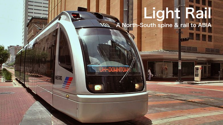 A silver light rail vehicle awaits passengers. It's sign reads 'Downtown'. Image text reads: Light Rail - A north-south spine & a connection to the ABIA